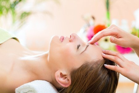33453649 - wellness - woman receiving head or face massage in spa